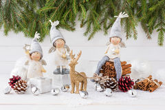 Christmas composition. Angels, Christmas tree, deer on white wooden background Royalty Free Stock Photos