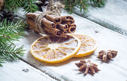 Christmas composition with anise stars, pine cones and dried orange Stock Images