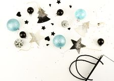Christmas composition background from black and blue Christmas decorations royalty free stock images