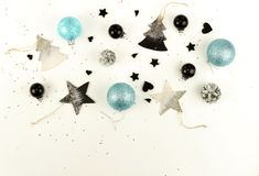 Christmas composition background from black and blue Christmas decorations royalty free stock image