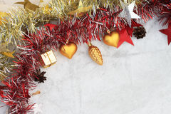 Christmas composition on a background of ice. Christmas decorations and tinsel on the ice background royalty free stock image