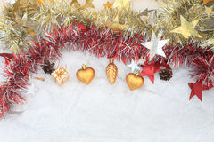 Christmas composition on a background of ice. Christmas decorations and tinsel on the ice background royalty free stock images