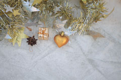 Christmas composition on a background of ice. Christmas decorations and tinsel on the ice background stock photos