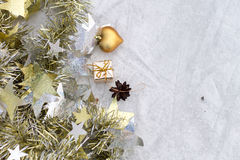 Christmas composition on a background of ice. Christmas decorations and tinsel on the ice background stock photo