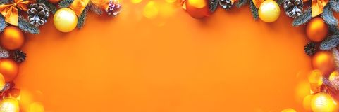 Christmas composition.  Background  orange colors with decorations. royalty free stock photos