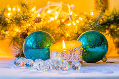 Christmas composition with balls and candle Stock Photos