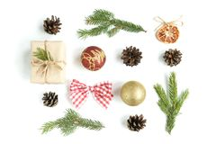Christmas composition of Christmas balls, gift box, cones and fir branches isolated on white background. stock image