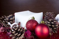 Christmas composition - balls and white candle Royalty Free Stock Photo