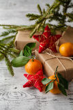 Christmas composition in basket with mandarins and fir tree Royalty Free Stock Photos