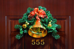 Christmas composition with bellflower on door Royalty Free Stock Photography