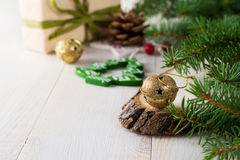 Christmas composition with bells and toys on light background. Selective focus Stock Photography