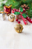 Christmas composition with bells and toys on light background. Selective focus. Royalty Free Stock Photos