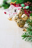 Christmas composition with bells and toys on light background. Selective focus. Stock Images