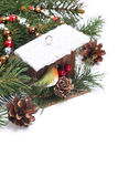 Christmas composition with birdhouse and fir branches Stock Photography