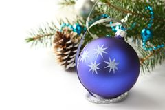 Christmas composition with blue ball and decoration over white Royalty Free Stock Photos
