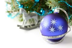 Christmas composition with blue ball and decoration over white Royalty Free Stock Images