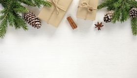 Christmas composition. Border made of christmas gifts and decoration. Christmas border composition made of fir branches, cones gift boxes wrapped in kraft paper royalty free stock image