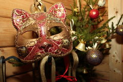 Christmas composition bouquet of tree with toys. And the Venice mask in a wooden house Royalty Free Stock Images