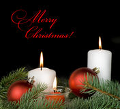 Christmas composition with a burning candles Royalty Free Stock Image
