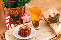 Christmas composition with cake and tea. Christmas composition with cake, tea, pine and present Stock Photography