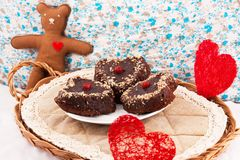Christmas composition with cakes. Christmas decorations with cakes, hearts and a bear Stock Images