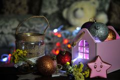 Christmas composition with a candle and Christmas decorations on a table royalty free stock images