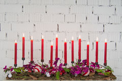Christmas composition. With candle and flowers Royalty Free Stock Photos