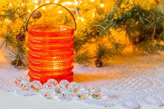 Christmas composition with a candle in a glass holder Stock Images