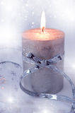 Christmas composition with candle and  ribbon Stock Image