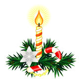 Christmas composition with candle and sugar cane. Christmas decoration made of fir twigs with candle and sugar cane Royalty Free Stock Photos