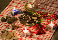Christmas composition with candles, decoration, spices, candies, dry tea and chocolate Stock Photos