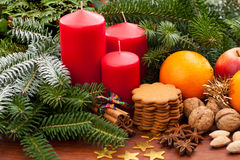 Christmas composition with candles and gingerbread Stock Photos