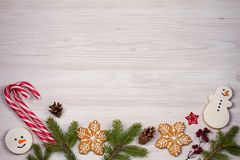 Christmas composition with candy canes, fir tree branches and ginger bread cookies Stock Image