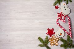 Christmas composition with candy canes, fir tree branches and ginger bread cookies Royalty Free Stock Photography
