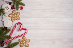 Christmas composition with candy canes, fir tree branches and ginger bread cookies Stock Photo