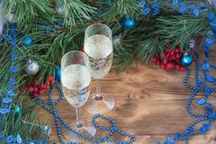 Christmas composition, champaign, pine, ornament decoration. Christmas and New Year still life composition with two champaign glasses, pine tree acerose, red royalty free stock photography