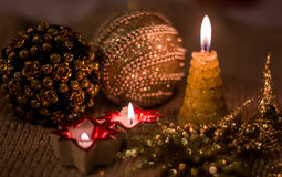 Composition with Christmas decorations and candles, decorated in gold tones. New Year's Eve. Merry christmas and a happy new. Composition with Christmas Stock Photos