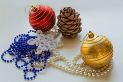 Christmas composition. Christmas decorations. Christmas toy.Balls, beads, cedar pine and paper snowflake, made in the style of quilling royalty free stock images