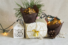 Christmas composition with Christmas dessert and a gift in retro style. Present in retro style, Christmas dessert, bumps on linen background. selective focus Royalty Free Stock Photo