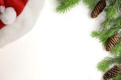 Christmas composition. Christmas frame of fir branches fir cone and Santa hat. Christmas Wallpaper. Flat position, top. Christmas composition. Christmas frame of Stock Photos