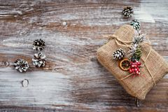 Christmas composition. Christmas gift, cones on vintage wooden background. Top view, flat lay, copy space, Place for text. Christmas composition. Christmas gift Stock Image