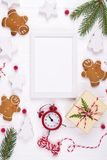 Christmas composition. Christmas gifts, decor, fir tree branches gingerbread man cookies . Winter holidays concept. Flat lay, top view, copy space royalty free stock photos
