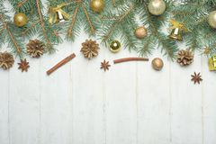 Christmas composition. Christmas gifts, pine cones, spruce branches on a wooden white background. Flat lay. view from royalty free stock images