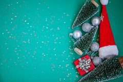 Christmas composition. Christmas gifts, red box, silver balls on green background. Flat lay, top view stock images