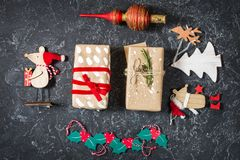 Christmas composition. Christmas gifts, toys on black stone background. Flat lay stock photography