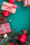 Christmas composition. Christmas green decorations, fir tree branches with toys gift boxes on green background. Flat lay. Top view, copy space royalty free stock photography
