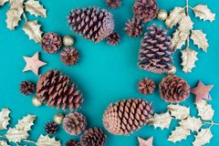 Christmas composition. Christmas green decorations, tree branches with bumps and stars on green background. Flat lay. Top view, copy space stock images