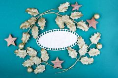 Christmas composition. Christmas green decorations, tree branches with bumps and stars on green background. Flat lay. Top view, copy space royalty free stock photography