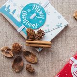 Christmas composition. Christmas red and white gifts boxes and cinnamon sticks on canvas background. Flat lay royalty free stock images