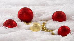 Christmas composition with Christmas toys, on white fluffy backg Stock Photos